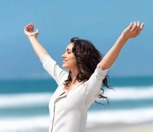 relaxed woman with hands in the air